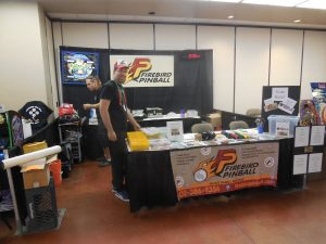 We were there bright and early, too, getting our Firebird Pinball booth set up just right. There's the boss doing the grunt work himself!