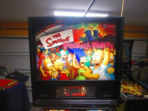 Interesting note on this game: All the voice work was by Dan Castellaneta, Nancy Cartwright, and Hank Azaria, custom recorded for the game. Cabinet and backglass art was created by Simpsons' guru Matt Groening's team.