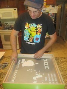 Here's the big boss getting one of the frames lined up just right. This is for a 1971 Gottlieb Star Trek!